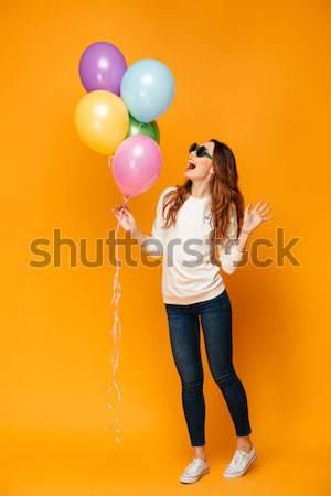 Shot vrouw lucht ballonnen skateboard Stockfoto © deandrobot