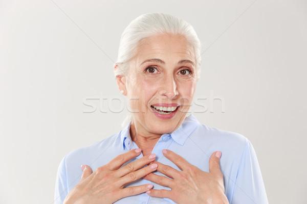 Photo étonné vieille dame mains poitrine regarder Photo stock © deandrobot