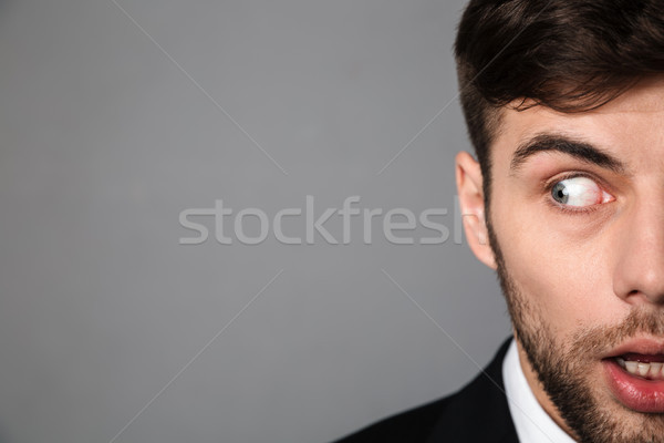 Cropped portrait frightened young bearded man looking aside Stock photo © deandrobot