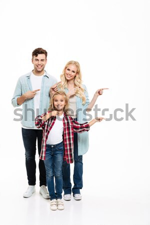 Full length portrait of a shocked young family Stock photo © deandrobot