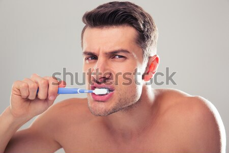 Close up portrait of a smiling man with shaving foam Stock photo © deandrobot