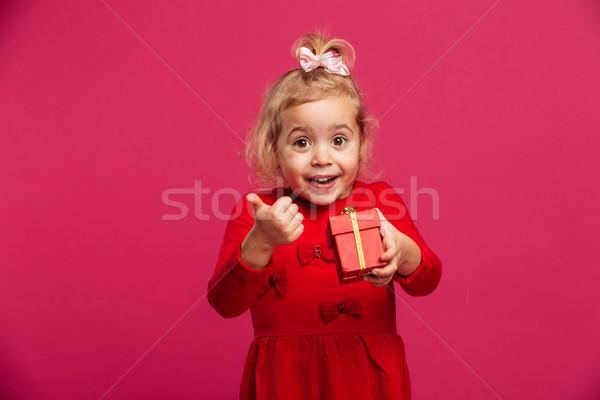 Genç kız kırmızı elbise Stok fotoğraf © deandrobot