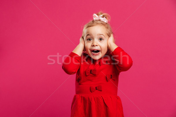 Conmocionado feliz joven vestido rojo cabeza Foto stock © deandrobot