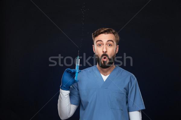портрет смешные мужской доктор равномерный шприц Сток-фото © deandrobot