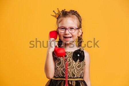 Sevimli küçük kız çocuk sahte dudaklar Stok fotoğraf © deandrobot