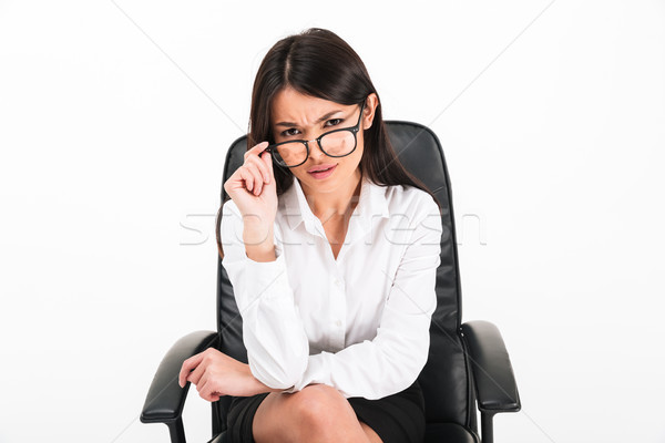 Portrait of a doubtful asian businesswoman Stock photo © deandrobot