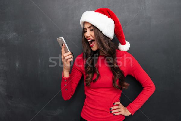 Boos brunette vrouw Rood blouse christmas Stockfoto © deandrobot