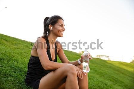 Portré mosolyog fitnessz nő fülhallgató pihen fű Stock fotó © deandrobot