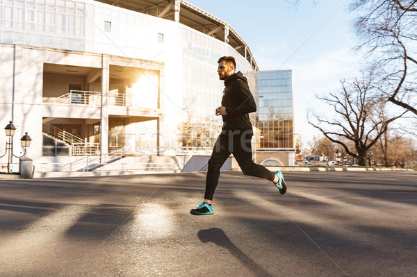 Portre motive genç kulaklık jogging Stok fotoğraf © deandrobot