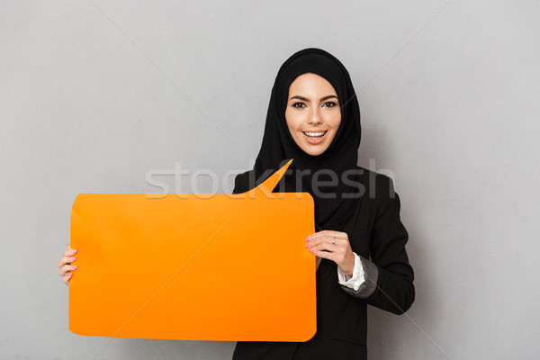 Portrait of muslim smiling woman 20s in black traditional clothi Stock photo © deandrobot