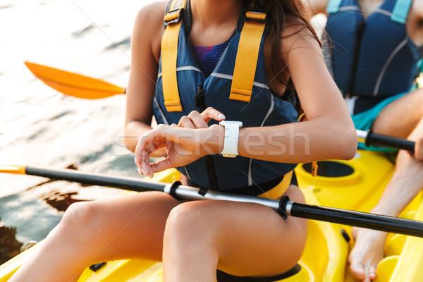 Mulher jovem caiaque lago mar barco ver Foto stock © deandrobot