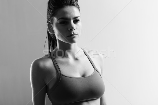 Black and white portrait of a young beautiful sport woman Stock photo © deandrobot