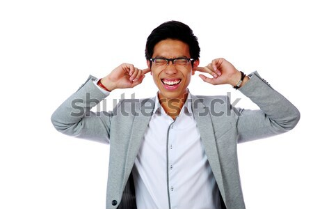 Stock photo: Portrait of man holding hands to ears covering to shut out noise