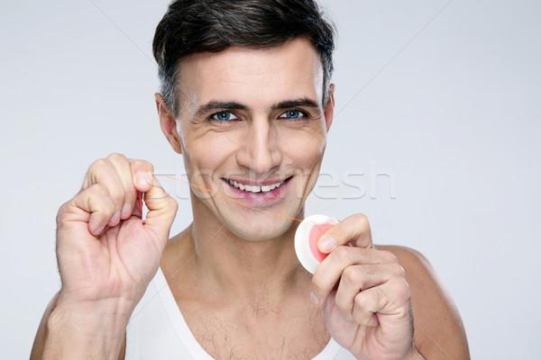 Portret gelukkig man flosdraad grijs studio Stockfoto © deandrobot