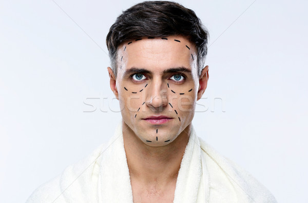 Man marked with lines for plastic surgery Stock photo © deandrobot
