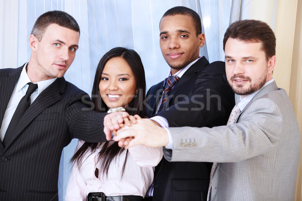 Portrait of a multi ethnic business team. Stock photo © deandrobot