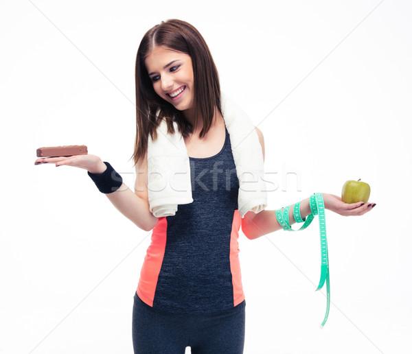 Smiling woman making choice between bananas and chocolate Stock photo © deandrobot