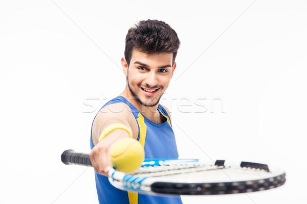 Mosolyog férfi tart teniszütő labda sportok Stock fotó © deandrobot