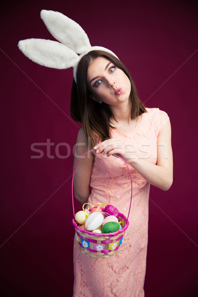 Beautiful woman with an Easter egg basket Stock photo © deandrobot