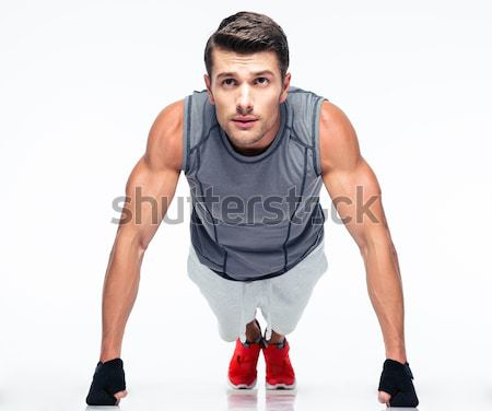 Fitness man tie shoelaces Stock photo © deandrobot