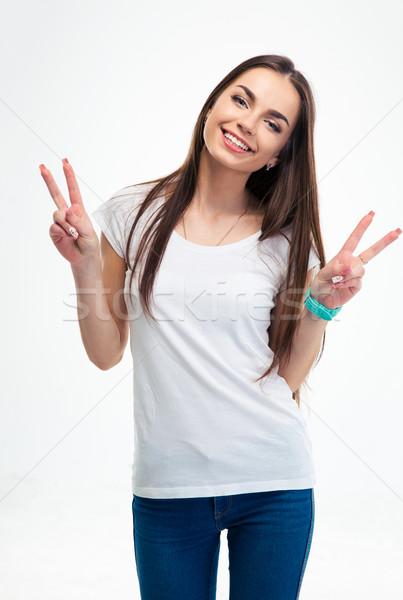 Kobieta dwa palce zwycięstwo gest Zdjęcia stock © deandrobot