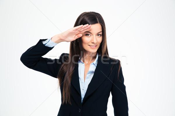 Happy attractive businesswoman saluting Stock photo © deandrobot