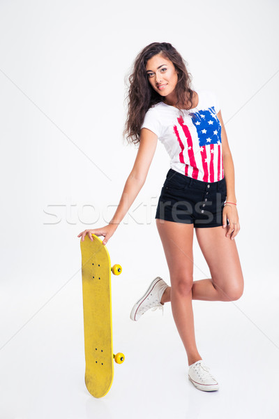 Happy teen girl holding skateboard  Stock photo © deandrobot