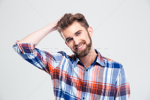 Portrait of smiling handsome man Stock photo © deandrobot