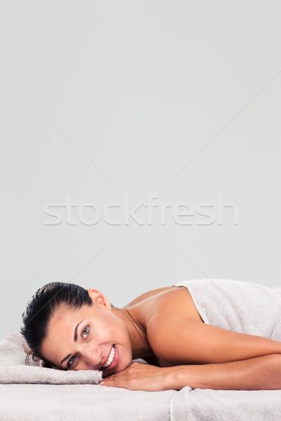 Charming woman lying on massage lounger  Stock photo © deandrobot
