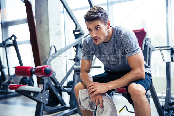 Fitness man resting at gym  Stock photo © deandrobot