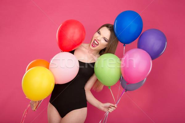 Gek schreeuwen jonge vrouw kleurrijk ballonnen bizar Stockfoto © deandrobot