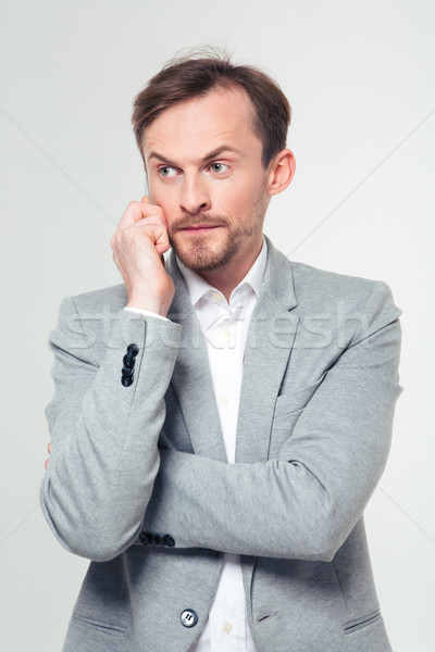 Serious businessman talking on the phone Stock photo © deandrobot