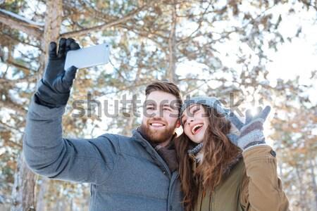 Couple making selfie photo in winter park Stock photo © deandrobot