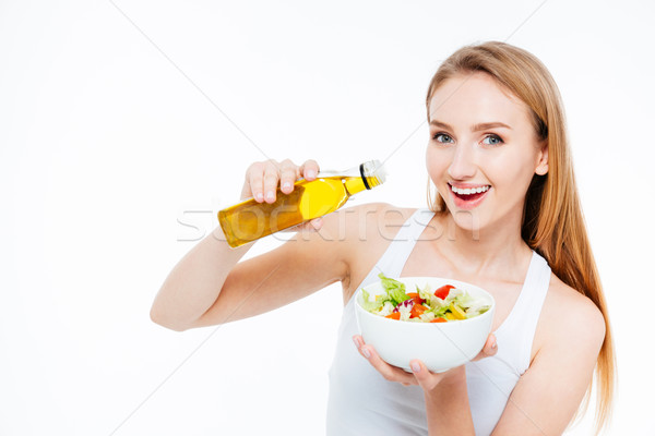Woman poured oil into salad Stock photo © deandrobot