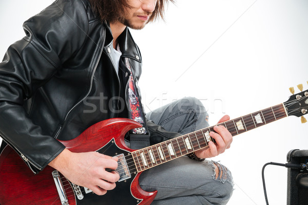 Closeup of concentrated young man playing electric guitar Stock photo © deandrobot