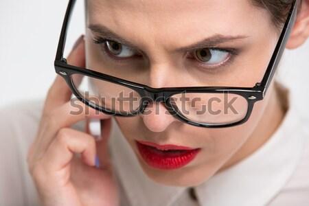 Sensual belo mulher de negócios lábios vermelhos olhando óculos Foto stock © deandrobot