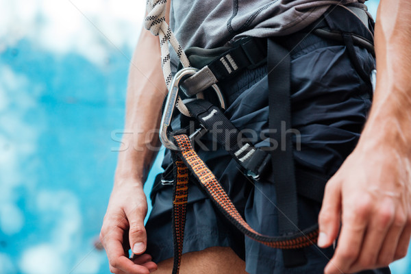Stock photo: Close-up of climber wearing safety harness and climbing equipment
