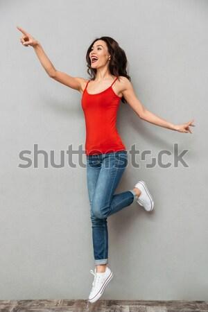 Hangsúlyos fiatal nő mutat üres izolált fehér Stock fotó © deandrobot