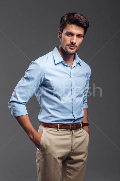 ハンサム 若い男 立って 手 孤立した グレー ストックフォト © deandrobot