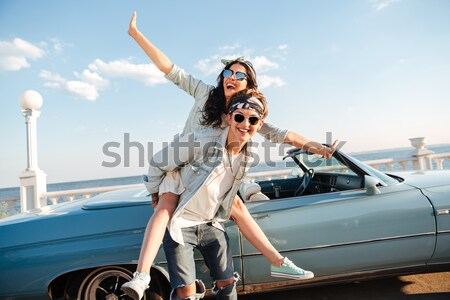 Two men holding their girlfriends and smiling in summer Stock photo © deandrobot