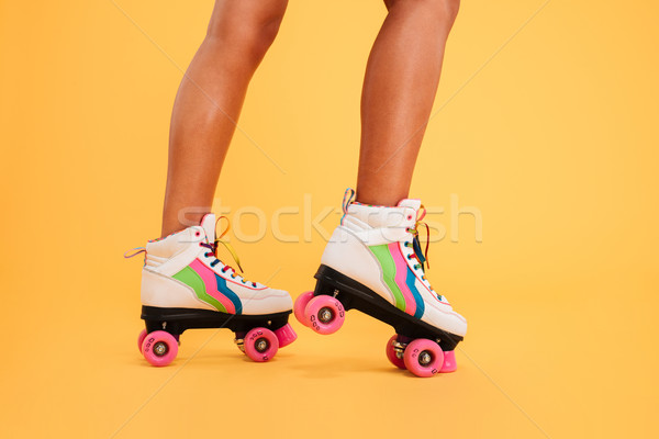 Cropped image of women legs wearing colorgul rollers Stock photo © deandrobot