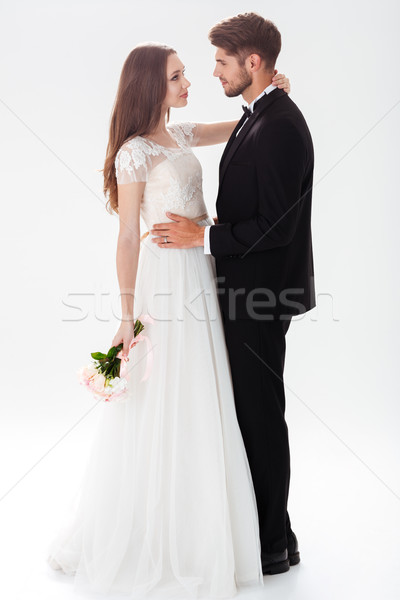 Full-length portrait of pretty newlyweds Stock photo © deandrobot