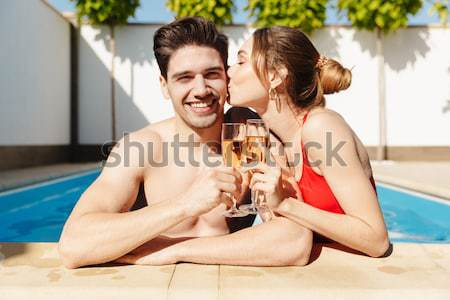 Happy woman in swimwear drinking cocktail over rusty metal background Stock photo © deandrobot