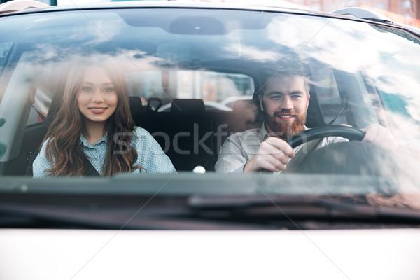 Hombre rueda mujer coche frente vista Foto stock © deandrobot