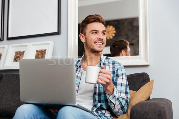 幸せ 剛毛 男 ラップトップを使用して コンピュータ 飲料 ストックフォト © deandrobot
