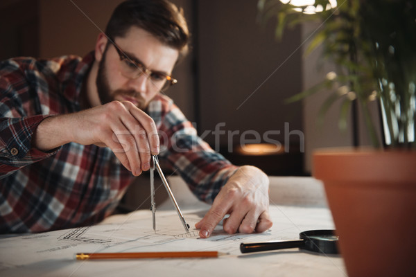 Man working with graph on the desk at office Stock photo © deandrobot