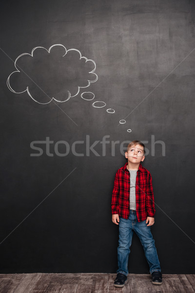 Child thinking with thought bubble over chalkboard Stock photo © deandrobot