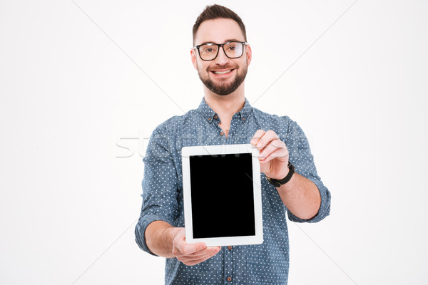 Happy bearded man showing tablet computer display Stock photo © deandrobot