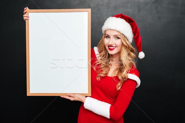 Kadın noel baba şapka beyaz tahta Stok fotoğraf © deandrobot