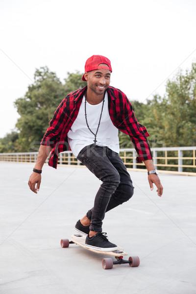 молодые темно человека скейтбординга фото Сток-фото © deandrobot
